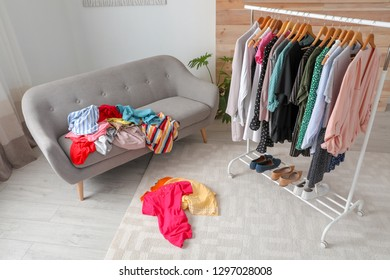 Mess in dressing room with sofa. Renew wardrobe