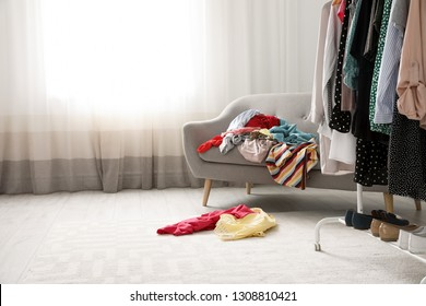 Mess in dressing room, space for text. Renew wardrobe
