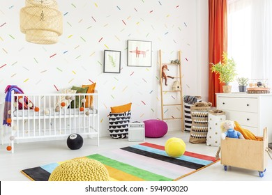 Mess in a modern white baby room in scandinavian style