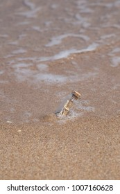 message in a bottle on beach