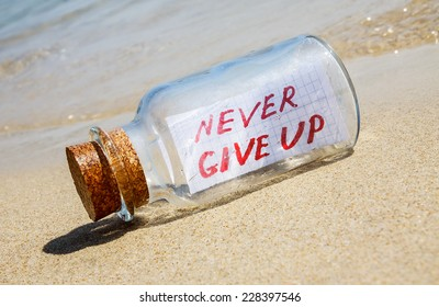 Message in a bottle on sandy beach. Creative hope and faith concept.