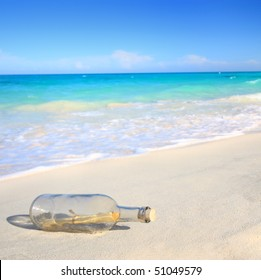 Message in a bottle washed ashore on a beach