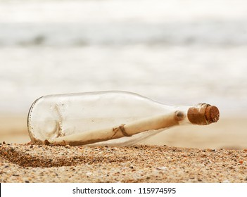 a Message in a bottle washed up on the beach, great business concept for snail mail, spam, or bad slow communication