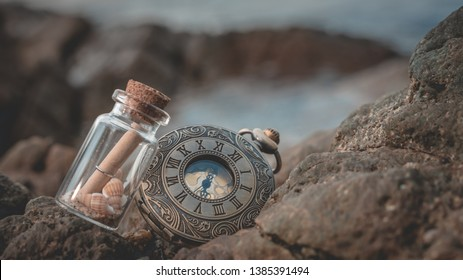 Message In Bottle And Watches Necklace On Sea Stone