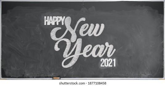 Message happy New Year 2021 written in chalk on a blackboard