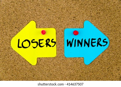 Message LOSERS versus WINNERS on yellow and blue paper notes as opposite arrows pinned on cork board with thumbtacks. Choice conceptual image