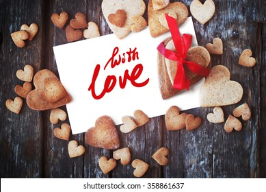 Message With Love on the White Isolated Letter and Gingerbread Cookies in the Shape of Heart at Valentine Day. Selective focus
