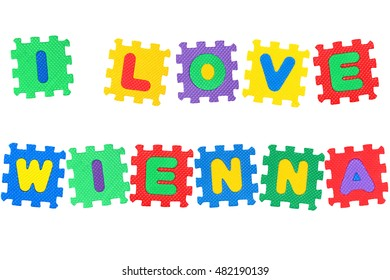 Message I Love Wienna, from letters puzzle, isolated on white background.