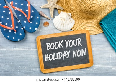 Message on a chalkboard - Book your holiday now