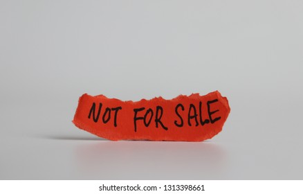 'NOT FOR SALE' message on the ripped paper.