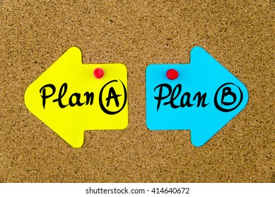 Message Plan A versus Plan B on yellow and blue paper notes as opposite arrows pinned on cork board with thumbtacks. Choice conceptual image
