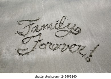 Message written in the sand, family forever
