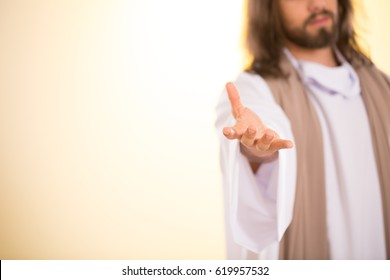 Messiah reaching out his hand isolated on illuminated background