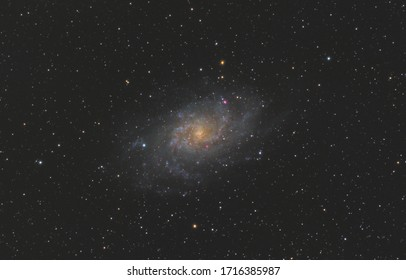 Messier 33 galaxy in triangulum constellation, with many stars as background in the deep space.