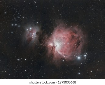 The Messier 42 in Orion constellation, with its dust colors and many stars as background taken with telescope.