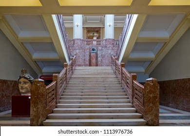 Messina, Italy - 26 march 2018: Staircase of Palazzo Zanca, the Town Hall of Messina, Sicily, Italy. In the center the bronze bust of Antonello da Messina, the famous painter.