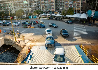 Messina, Italy - 9.02.2019: Cars boarding to ferry in Messina in Sicily, Italy