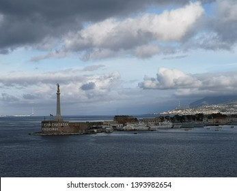 Messina, Italy - December 24, 2018: Messina Monument with 7 metre tall, golden Madonnina guarding the city and Messina port in Italy.