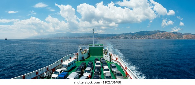 MESSINA, ITALY - JUNE 18, 2017: View of the Messina sea strait and coastline from the side of the ferry to Sicily island, Italy