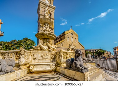 Messina, Italy - September 14 2016: Messina Cathedral on the Mediterranean island of Sicily, Italy. Reclining marble figures and a sphinx highlight the Fountain of Orion