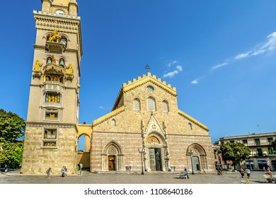 Messina, Italy - September 16 2016: Tourists visit the Messina Cathedral and it's ornate bell tower on the Piazza Duomo in the Sicilian city of Messina, Italy.