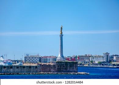"MESSINA, SICILY/ITALY - JULY 29 2017 : ""The Madonna della Lettera"" monument at the entrance of Messina port in Sicily island.  View of Messina port in Sicily island Italy."