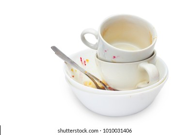 Messthetics aesthetic concept. A photo of dirty empty ceramic cups, bowls, two spoons and a plate isolated on white background. Dish ready for washing. Food leftovers after breakfast for recycling