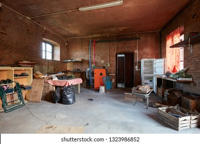 Messy basement with red bricks walls in old country house