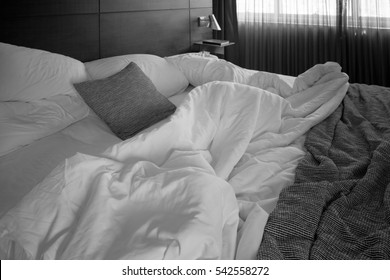 Messy bed in hotel. Image made black and white tone