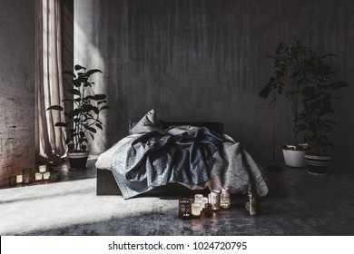 Messy bed in a monochromatic shadowy grey loft bedroom interior with streaky walls, window with long drapes and potted plants. 3d rendering