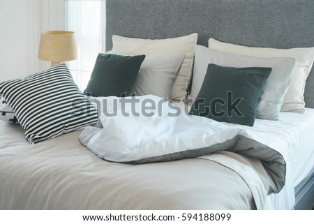 Messy bed pillows modern interior bedroom stock photo edit now