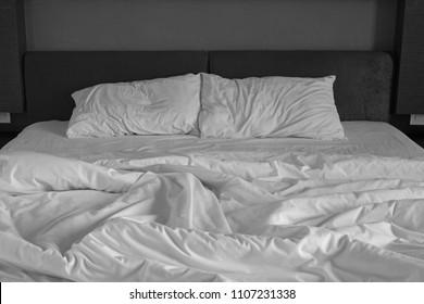 Messy bed sheets and pillow