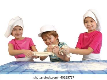 Messy children preparing dough