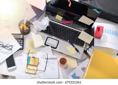 Messy and cluttered office desk, light effect