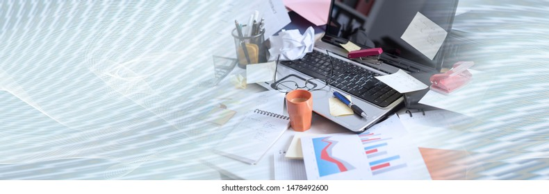 Messy and cluttered office desk; panoramic banner