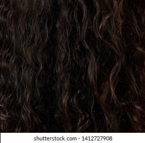 Messy curly brown hair closeup. Latina curls details