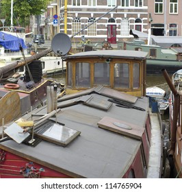messy deck of an old barge in a canal in groningen, netherlands
