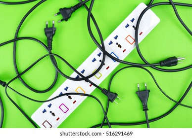Messy of electrical cords plugs and wires unconnected electrical power strip or extension block  with messy wires, top view on colorful background, messy electric equipment flat lay concept.