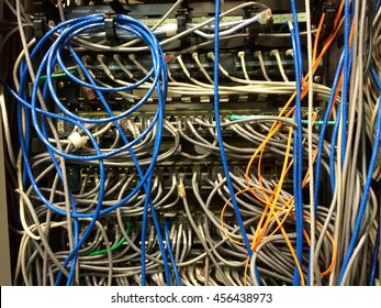 MESSY LAN/UTP cable and FIBER on network rack at DATA CENTER