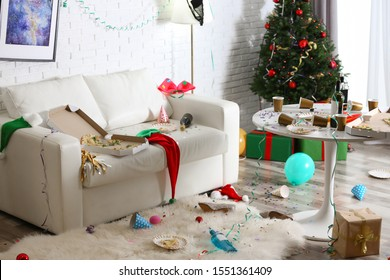 Messy living room interior with Christmas tree. Chaos after party