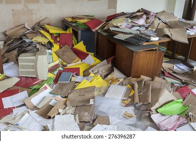 messy office full of folders and papers after the company went bankrupt