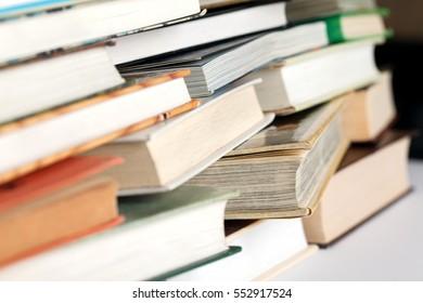 Messy pile of books. Selective focus, low aperture shot