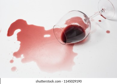 Messy Spilled Red Wine on White Surface