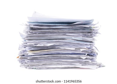 messy stacked pile of paperwork isolated on white background