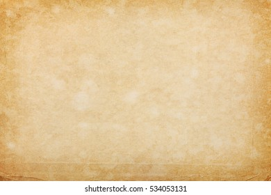 Messy textured aged bright paper background with spots and folds