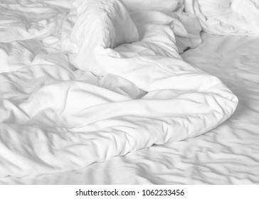 messy white bed sheets background
