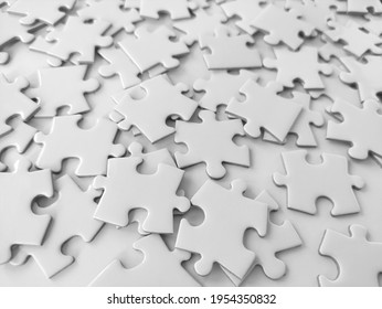 Messy white jigsaw puzzle pieces