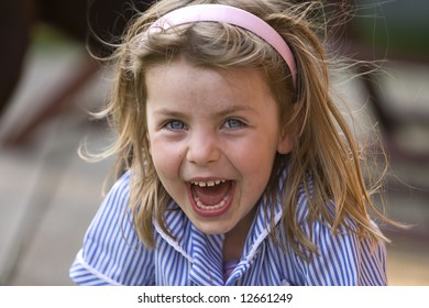 Messy Young Girl Laughing