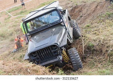 "MESTECKO TRNAVKA,  CZECH REPUBLIC - AUG 29: Off road car is overcoming a  difficult terrain at ""Big Shock Cup 2015"" on August 29, 2015  in Mestecko Trnavka, Czech Republic."