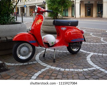 Mestre, Venice/Italy - 6/4/2018: Red scooter parked on a street in Mestre, Metropolitan City of Venice, Italy